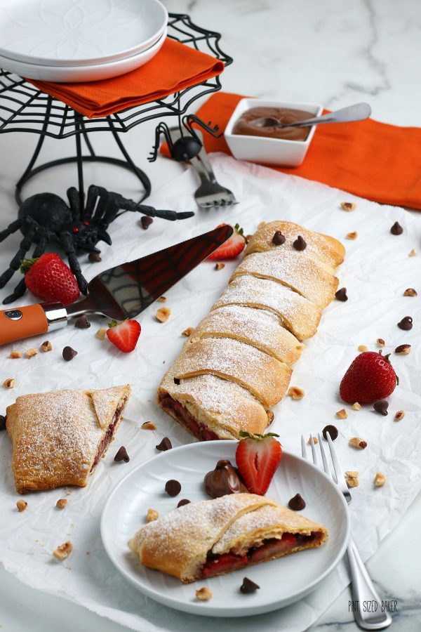 An image of the fun Halloween Mummy Pastry with spooky décor and a bowl of Nutella.