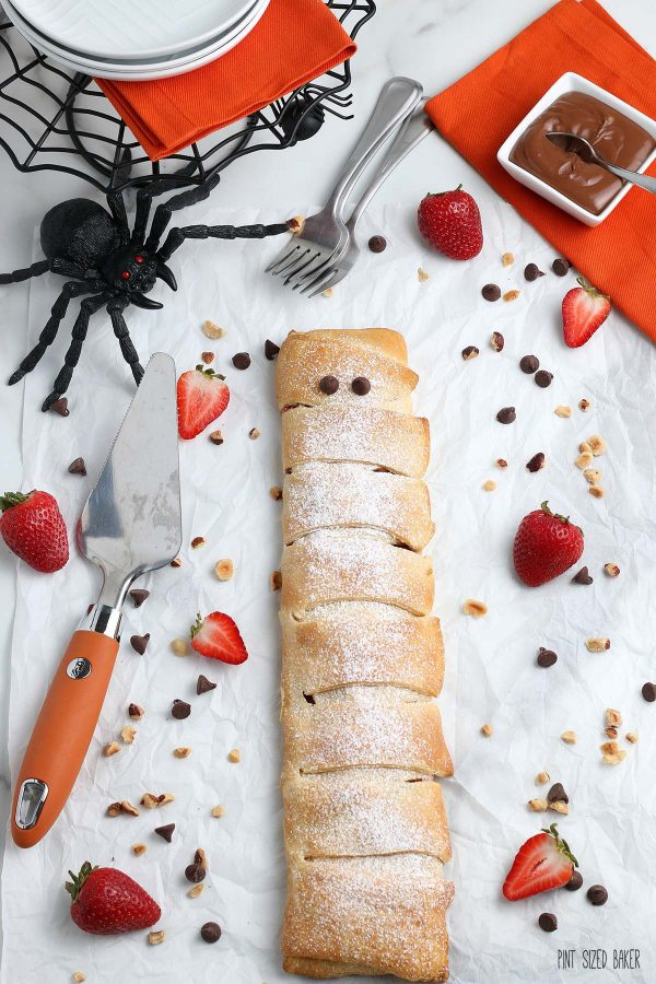 A photo of the full pastry wrap with chocolate chip eyes to make a Halloween Mummy.