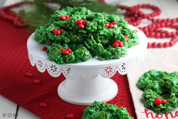 Horizontal image of the cookies on a simple white cake stand with red napkins underneath it.