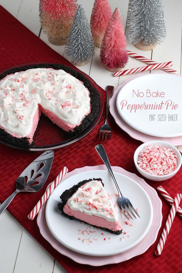 Lead in image of the No Bake Peppermint Pie with a slice of the pie on a white plate and pink charger.