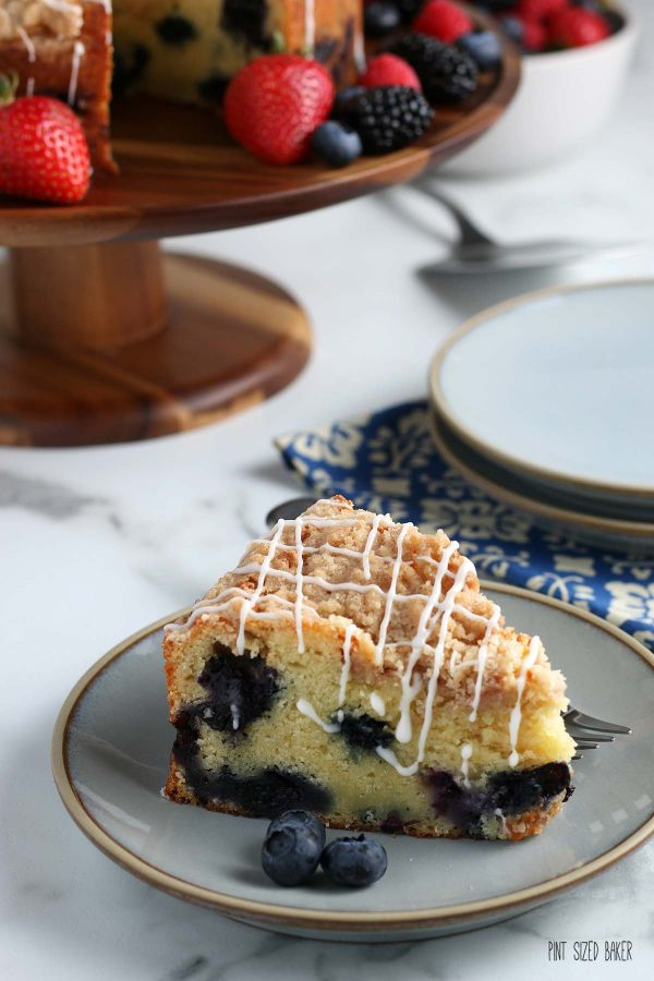 Another close image of the slice of blueberry coffee cake.
