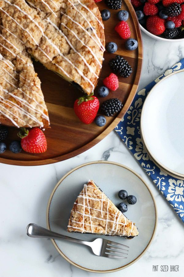 An overhead image of the crumble and glaze on the coffee cake with fresh berries on the side.