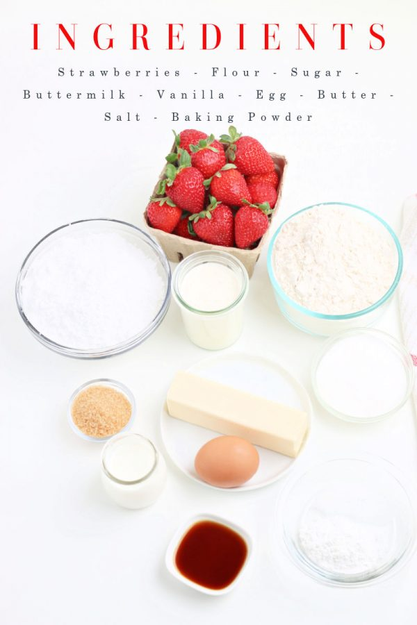 Image of all the ingredients needed to make the scones. Strawberries, flour, milk, sugar, egg, butter, vanilla, salt, and baking powder.