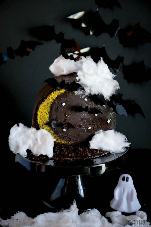 A night time Halloween cake with cotton candy clouds. Don't add the cotton candy until you're ready to serve the cake or it will melt.