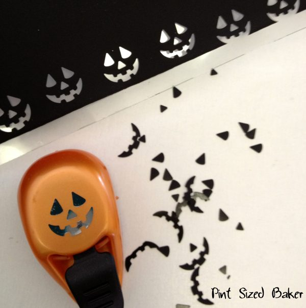 Use a Jack-o-Lantern hold punch to make the candy face for your cake pops.